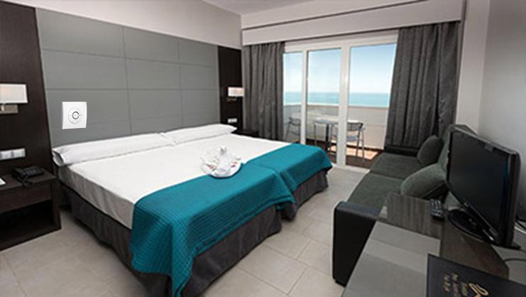 Ahorro de energ a en cuartos de hotel ilumina for Hoteles con habitaciones comunicadas